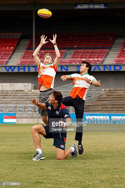 Force India drivers Nico Hulkenberg and Sergio Perez pratice their marking skills on Will Minson of the Western Bulldogs during a meet the drivers...