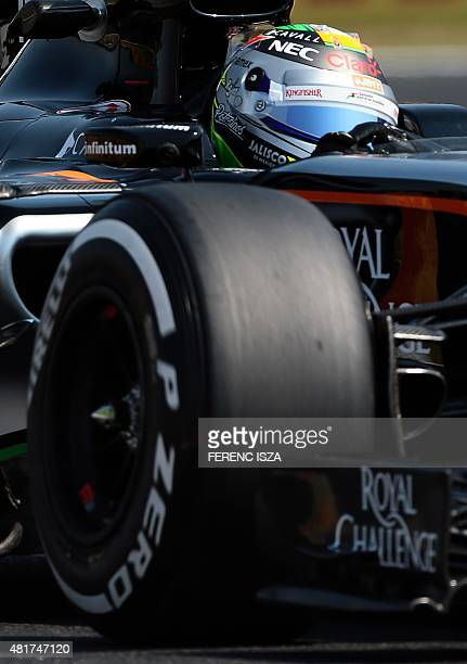 Force India F1 Team's Mexican driver Sergio Perez steers his car during the first practice session of the Hungarian Grand Prix Formula One race on...