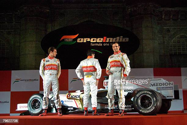 Force India Formula One team drivers Adrian Sutil of Germany, Vitantonio Liuzzi and Giancarlo Fisichella of Italy pose with the new Force India...