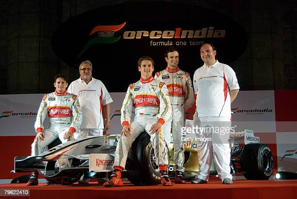 Force India Formula One team drivers Giancarlo Fisichella Vijay Mallya Vitantonio Luizzi Adrian Sutil and Collin Kolles pose with the new Force India...