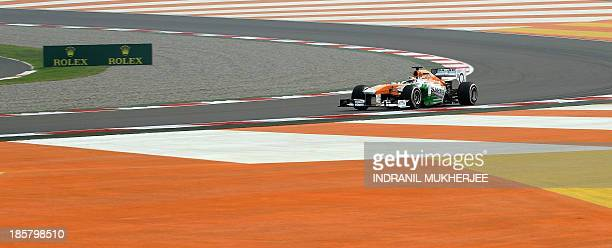 Force India reserve driver James Calado of Britain drives his car during the first practice session at The Buddh International circuit in Greater...