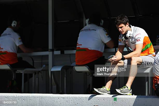 Force India reserve driver James Calado of Great Britain sits on the pitwall during practice for the Japanese Formula One Grand Prix at Suzuka...