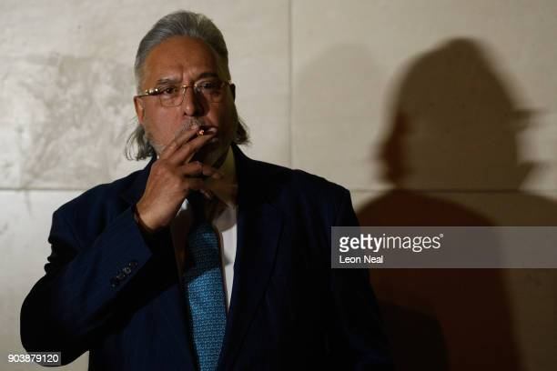 Force India team boss Vijay Mallya stands outside The City of Westminster Magistrates Court at the end of the day's proceedings on January 11 2018 in...