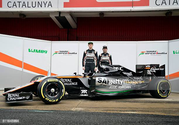 Force India team German driver Nico Hulkenberg and Mexican pilot Sergio Perez pose by their new VJM09 car during the official presentation at the...