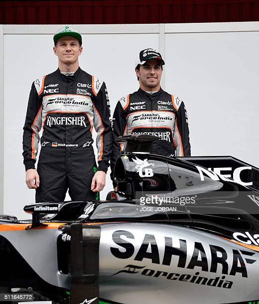 Force India team Mexican driver Sergio Perez and German pilot Nico Hulkenberg pose behind of their new VJM09 car during the official presentation at...