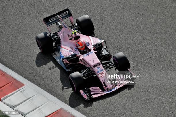 Force India's British George Russell drives his car during the first practice session ahead of the Abu Dhabi Formula One Grand Prix at the Yas Marina...