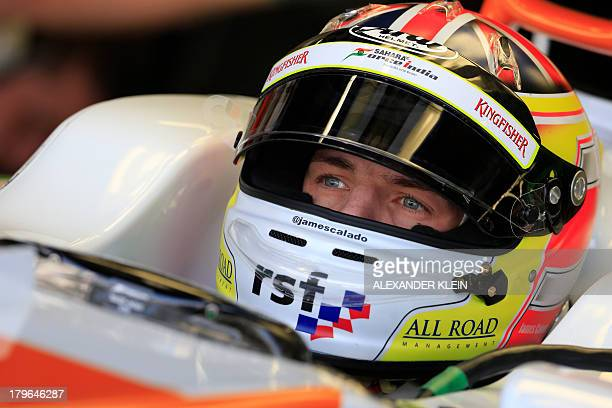 Force India's British test driver James Calado in the pits during the first practice session at the Autodromo Nazionale circuit in Monza on September...