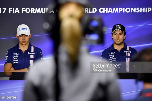 Force India's French driver Esteban Ocon and Force India's Mexican driver Sergio Perez give a press conference at the Autodromo Nazionale circuit in...