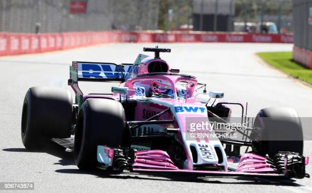 Force India's Mexican driver Sergio Perez drives around the Albert Park circuit during the first Formula One practice session in Melbourne on March...