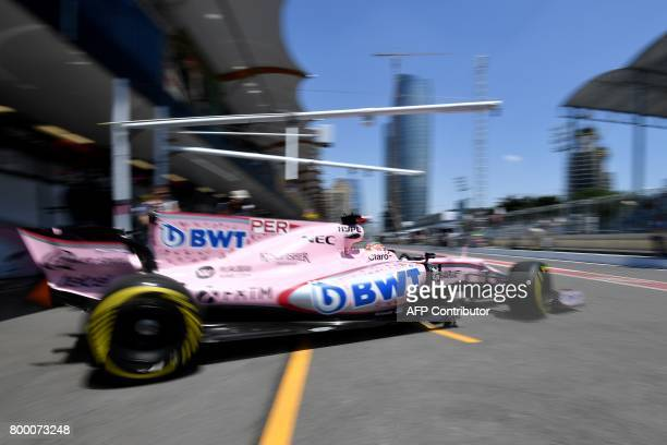 Force India's Mexican driver Sergio Perez drives out of the garage during the first practice session of the Formula One Azerbaijan Grand Prix at the...