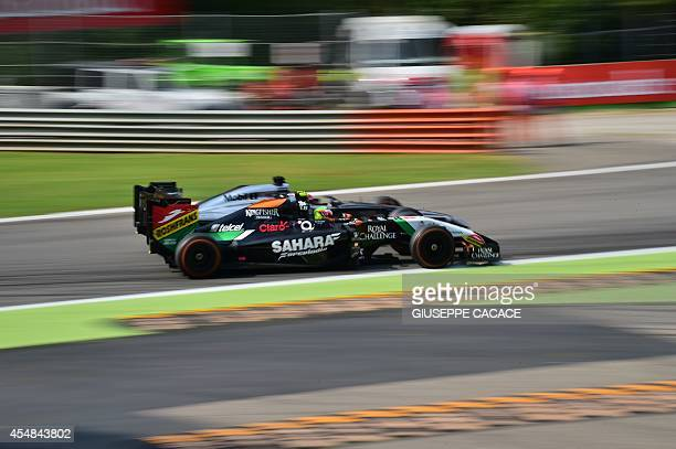 Force India's Mexican driver Sergio Perez steers his car during the Italian Formula One Grand Prix motor race at the Autodromo Nazionale circuit in...