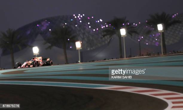 Force India's Mexican driver Sergio Perez steers his car during the qualifying session ahead of the Abu Dhabi Formula One Grand Prix at the Yas...