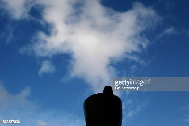 Forced perspective of cloud coming out of coffee mug