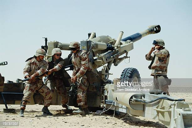 US forces during a live firing exercise in the desert while training in Saudi Arabia before the allied intervention in Kuwait during the Persian Gulf...
