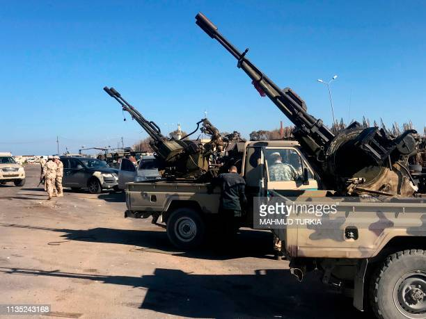 Forces loyal to Libya's UNbacked unity government arrive in Tajura a coastal suburb of the Libyan capital Tripoli on April 6 from their base in...
