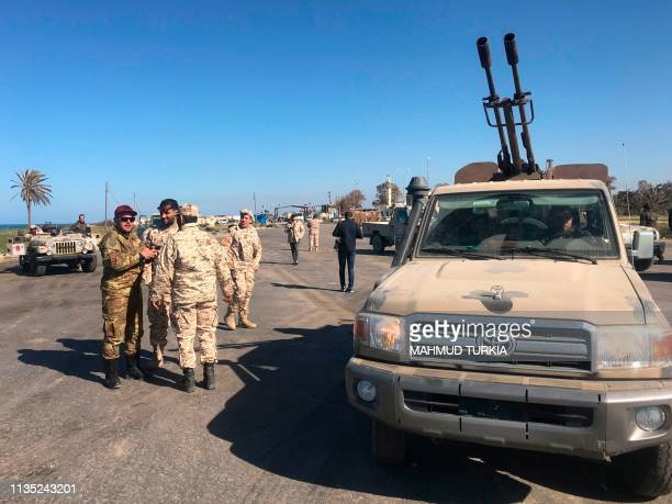 Forces loyal to Libya's UN-backed unity government arrive in Tajura, a coastal suburb of the Libyan capital Tripoli, on April 6 from their base in...