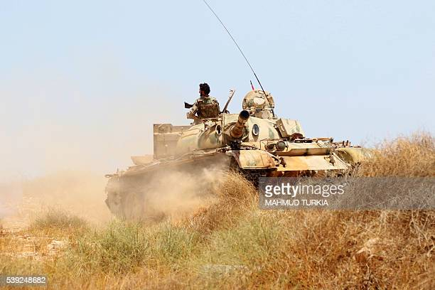 Forces loyal to Libya's UN-backed unity government fire from a tank in Sirte's centre towards Ouagadougou as they advance to recapture the city from...