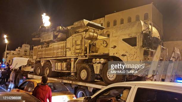 Forces loyal to Libya's UN-recognised Government of National Accord parade a Russian-made Pantsir air defense system truck in the capital Tripoli on...