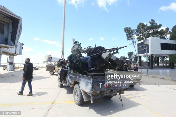 Forces loyal to the internationally recognised Libyan Government of National Accord drive through Tripoli's old airport on April 8, 2019. - Libyan...