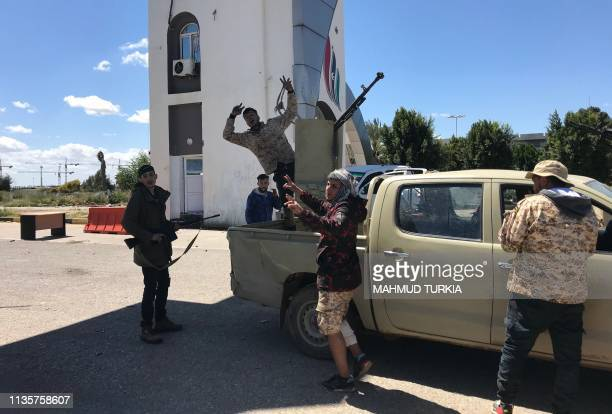 Forces loyal to the internationally recognised Libyan Government of National Accord are pictured at the entrance gate leading to Tripoli's old...