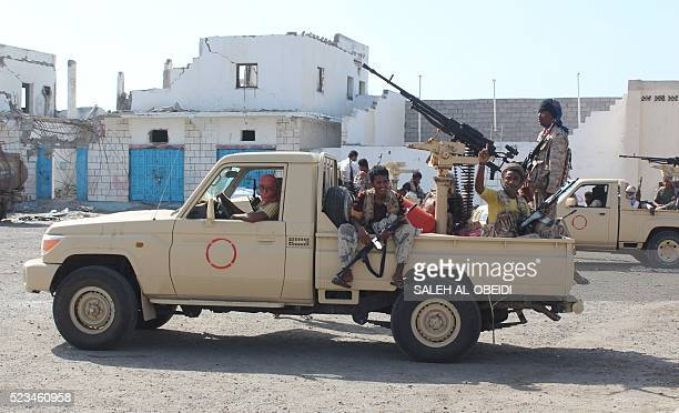 Forces loyal to the Saudibacked Yemeni president drive an armed vehicle on a road leading to the entrance of Abyan province as they take part in an...