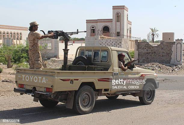Forces loyal to the Saudibacked Yemeni president patrol a street in the southern city of Lahj on April 24 2016 during an operation to drive AlQaeda...