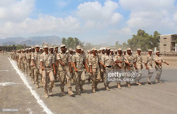 Forces loyal to the Saudibacked Yemeni president show their skills during a graduation ceremony at a military base in Khor Maksar in the Yemeni...