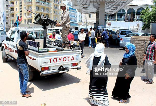 Forces loyal to the Saudibacked Yemeni president stand guard in the West of the southern Yemeni city of Aden on April 11 2016 A UNbrokered ceasefire...