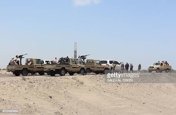 Forces loyal to the Saudibacked Yemeni president stand guard on a road at the entrance to Abyan province as they take part in an operation to drive...