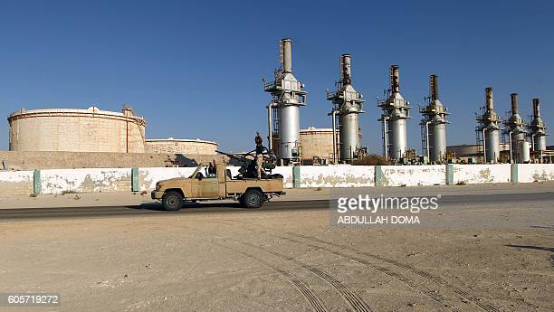 Forces opposed to Libya's unity government ride a truck in the Zueitina oil terminal on September 14 2016 Forces opposed to Libya's unity government...