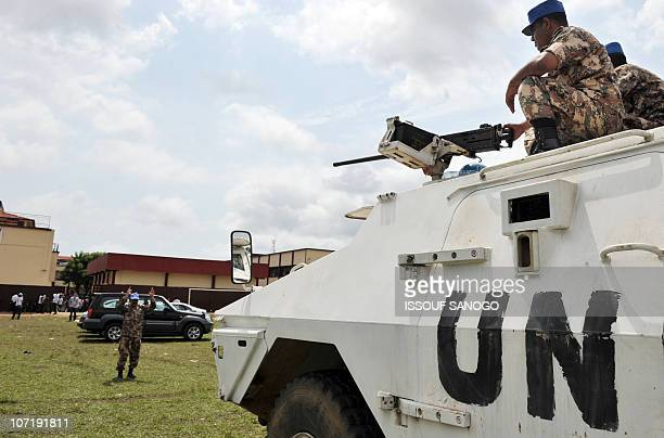 UN forces soldiers stand guard near a vote counting center on November 29 2010 in Yopougon an Abidjan suburb a day after Ivory Coast's second round...