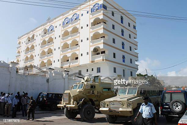 forces stand guard on a bomb blast area in front of the Mogadishu hotel on September 12 2012 where the newly elected Somali president Hasan Sheikh...