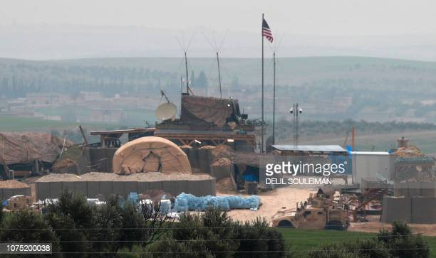 US forces' vehicles and structures are seen on the outskirts of the northern Syrian town of Manbij in the village of Dadat on the demarcation line...