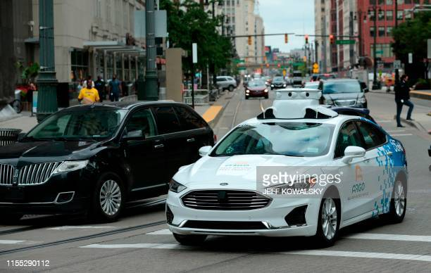A Ford Argo AI test vehicle being tested drives through the downtown area in Detroit Michigan on July 12 2019 Volkswagen and Ford are teaming up on a...