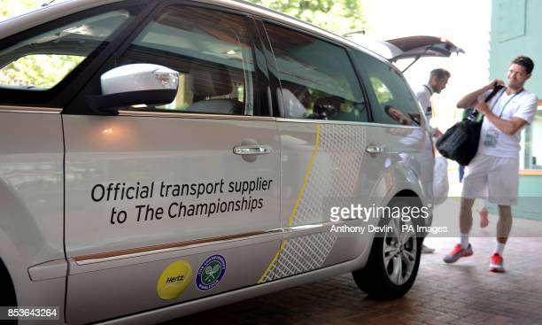Ford cars sponsored by Hertz transport players to the Championship during day three of the Wimbledon Championships at the All England Lawn Tennis and...