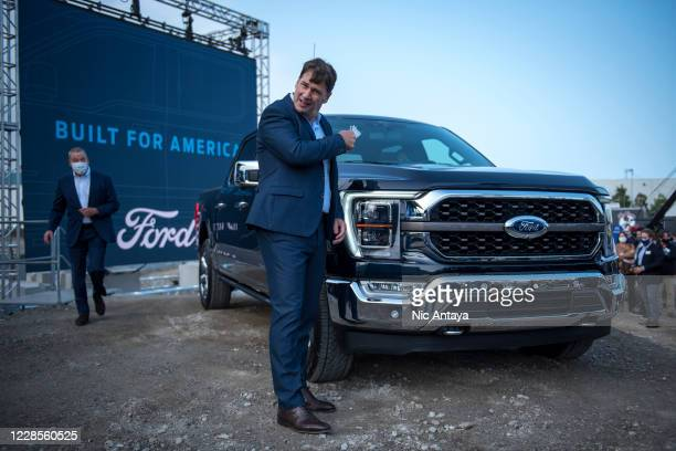 Ford CEO Jim Farley takes off his mask at the Ford Built for America event at Fords Dearborn Truck Plant on September 17, 2020 in Dearborn, Michigan....