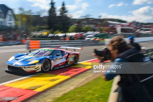 Ford Chip Ganassi Racing Ford GT race car of Stefan Mücke and Olivier Pla driving on track where a photorgrapher is taking a picture 9during the 6...