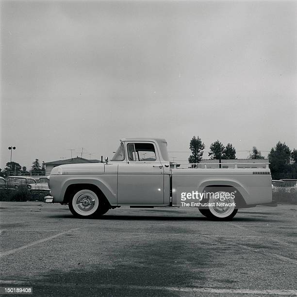 Ford Custom Cab Pickup Truck parked in an empty outdoor parking lot Various angles to show trucks details Twotone paint scheme