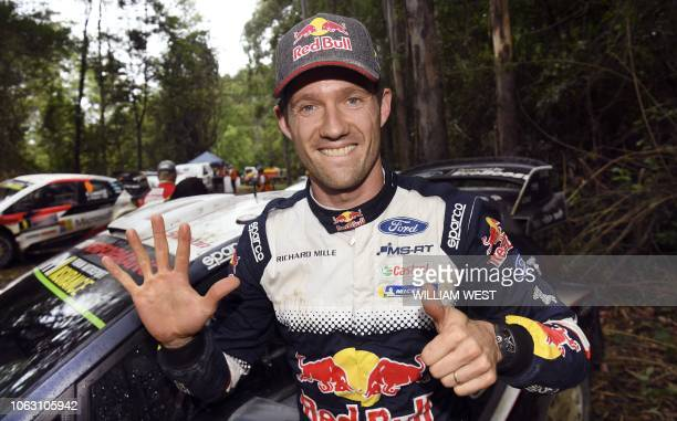 TOPSHOT Ford driver Sebastien Ogier of France celebrates winning his sixth world rally title after finishing fifth on the final day of the World...