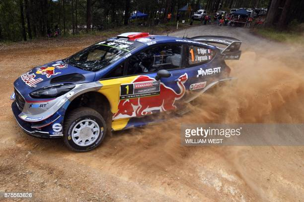 Ford driver Sebastien Ogier of France slides through a corner on the second day of World Rally Championship event Rally Australia near Coffs Harbour...
