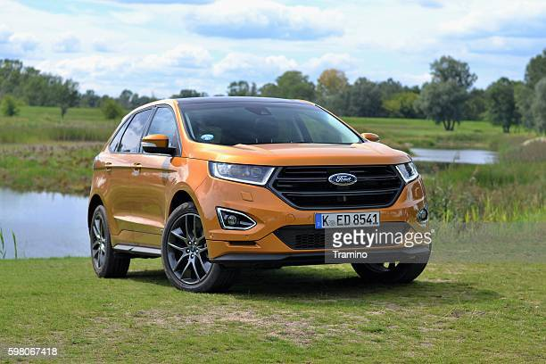 ford edge on the grass - build grill stock photos and pictures