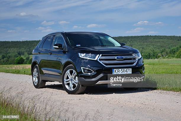 ford edge on the road - ford motor company stock pictures, royalty-free photos & images