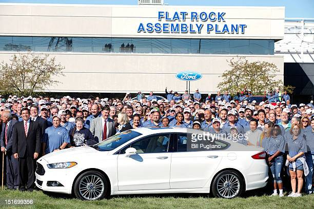 Ford employees pose for a group portrait at an event that celebrates the opening of the new US production line where the 2013 Ford Fusion midsize...