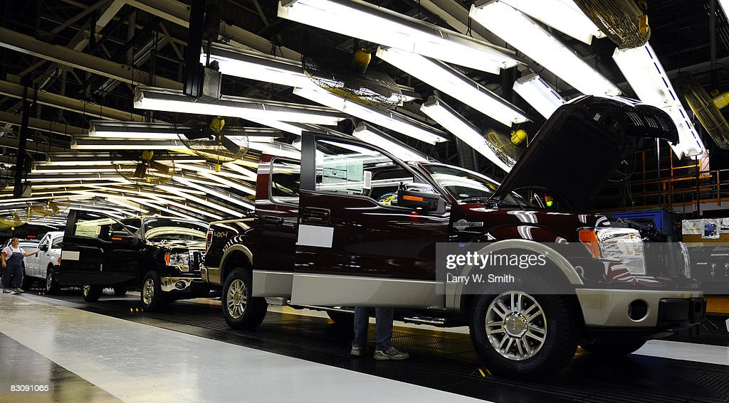 Ford employees work on the final assembly line for the Ford F-150 pickup at the Kansas City Ford Assembly plant October 2, 2008 in Claycomo, Missouri. Ford's Kansas City Assembly plant celebrates production of the new 2009 Ford F-150 with the official roll out.