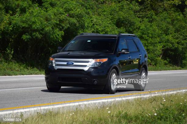 ford explorer in motion - ford motor company stock pictures, royalty-free photos & images