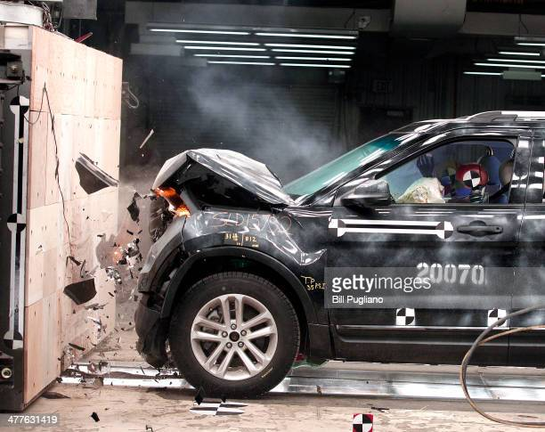 Ford Explorer XLT performs a fullfrontal crash impact test into a wall at 30mph at the Crash Barrier Dearborn Development Center March 10 2014 in...