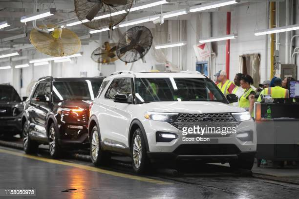 Ford Explorers gets a final inspection as they roll off the assembly line at the Chicago Assembly Plant on June 24, 2019 in Chicago, Illinois. Ford...