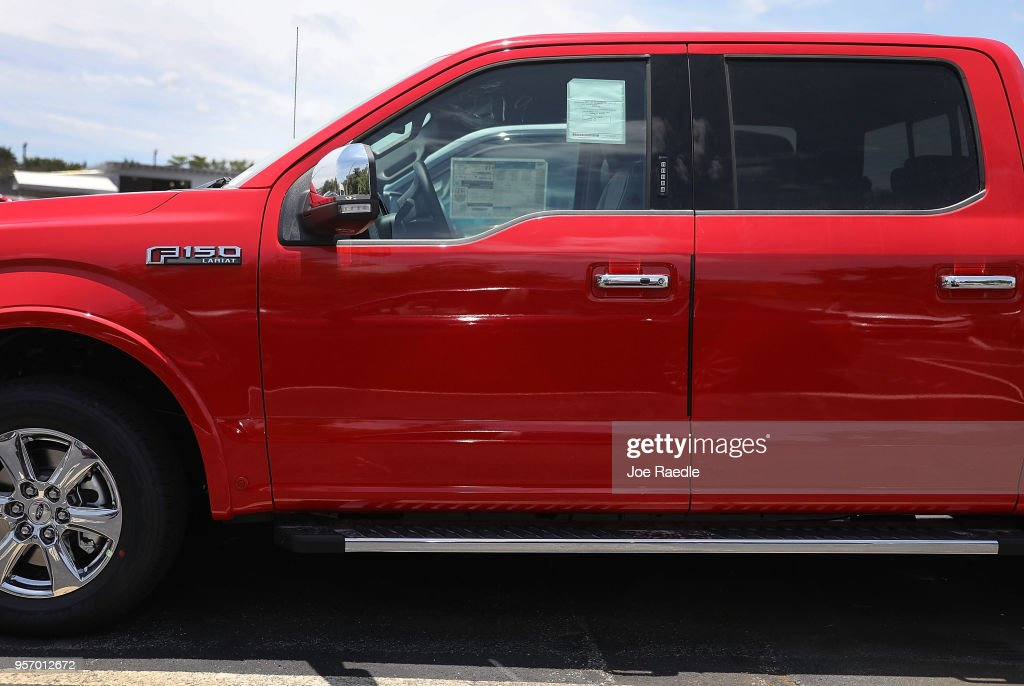 A Ford F-150 pickup truck is seen on a sales lot on May 10, 2018 in Miami, Florida. The company announced it is suspending production of its F-150 trucks after a fire at a supplier's facility caused it to run out of some parts needed in the production of the truck.