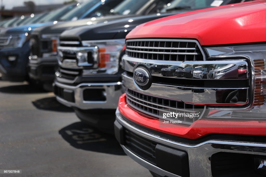Ford F-150 pickup trucks are seen on a sales lot on May 10, 2018 in Miami, Florida. The company announced it is suspending production of its F-150 trucks after a fire at a supplier's facility caused it to run out of some parts needed in the production of the truck.