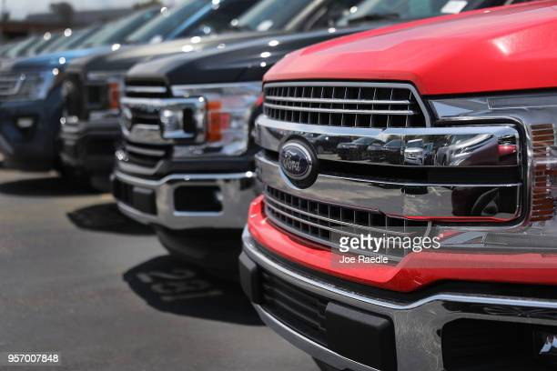 Ford F150 pickup trucks are seen on a sales lot on May 10 2018 in Miami Florida The company announced it is suspending production of its F150 trucks...
